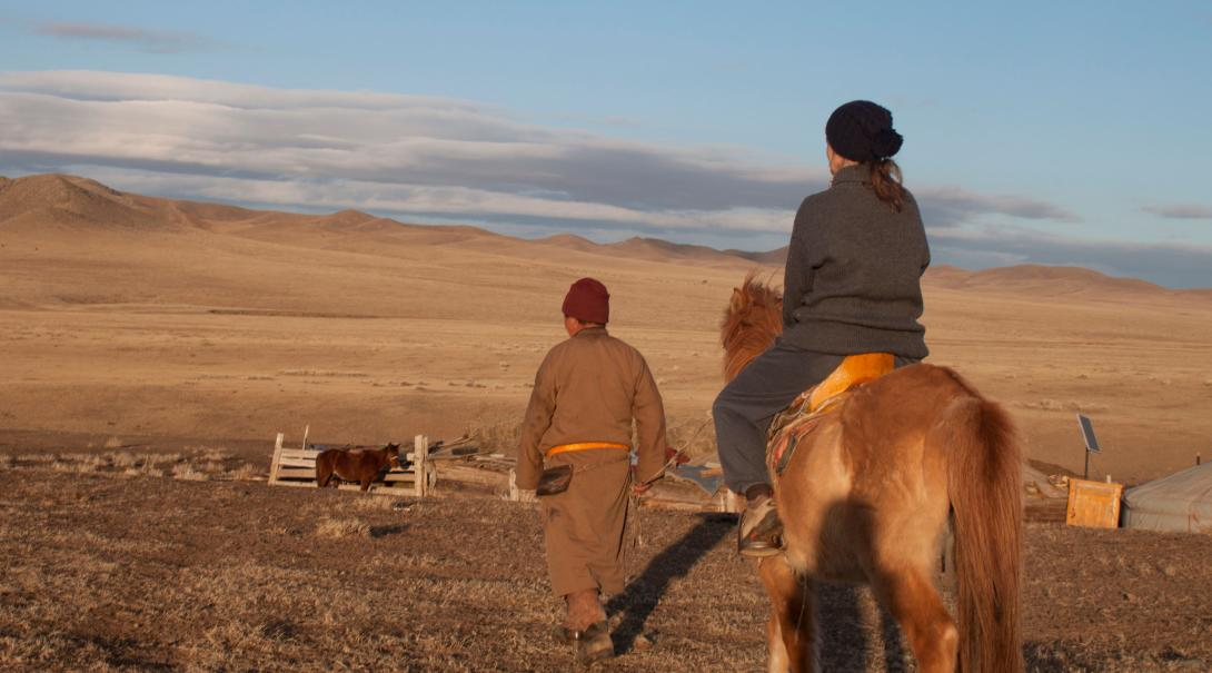 Nomads living on the Mongolian Steppe take care of their farm animals.